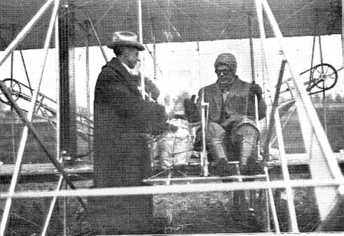 Max Morehouse greets pilot Philip O. Paemalee