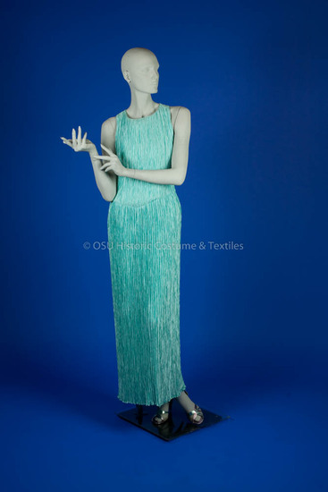 McFadden, 1975-80 Aqua polyester pleated dress with T-back.